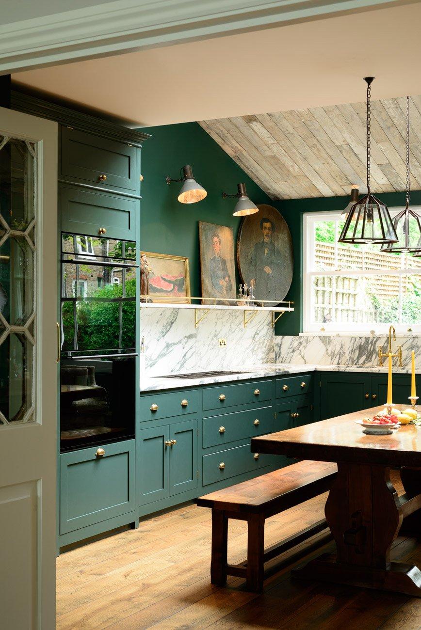 DeVol Kitchen design with fine art & hunter green cabinets.
