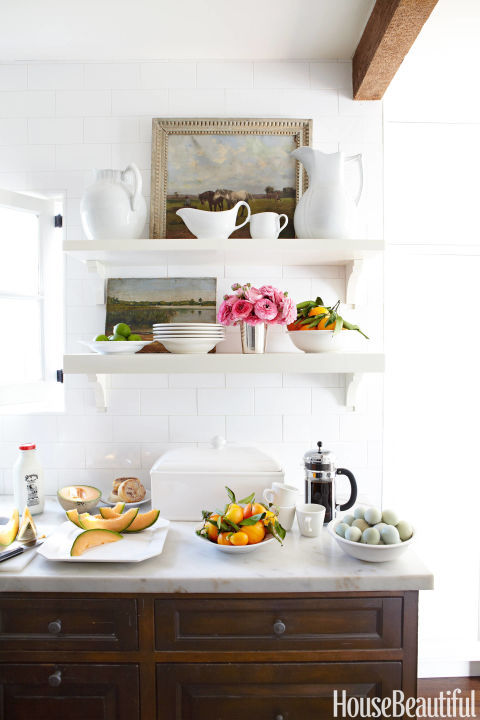Open shelving with fine art in kitchen •House Beautiful | Victoria Pearson | Chris Barrett