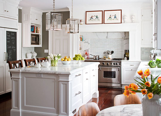 Art above stove in Christopher Peacock's kitchen •Traditional Home •Bessler