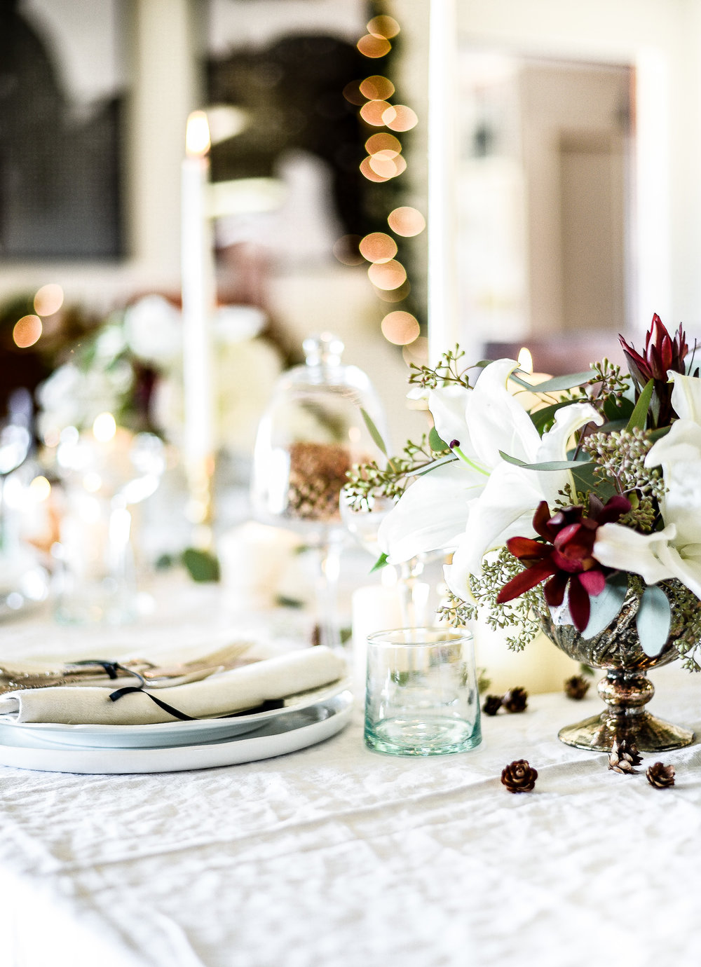 White holiday tablescape with greenery and vintage linens | boxwoodavenue.com