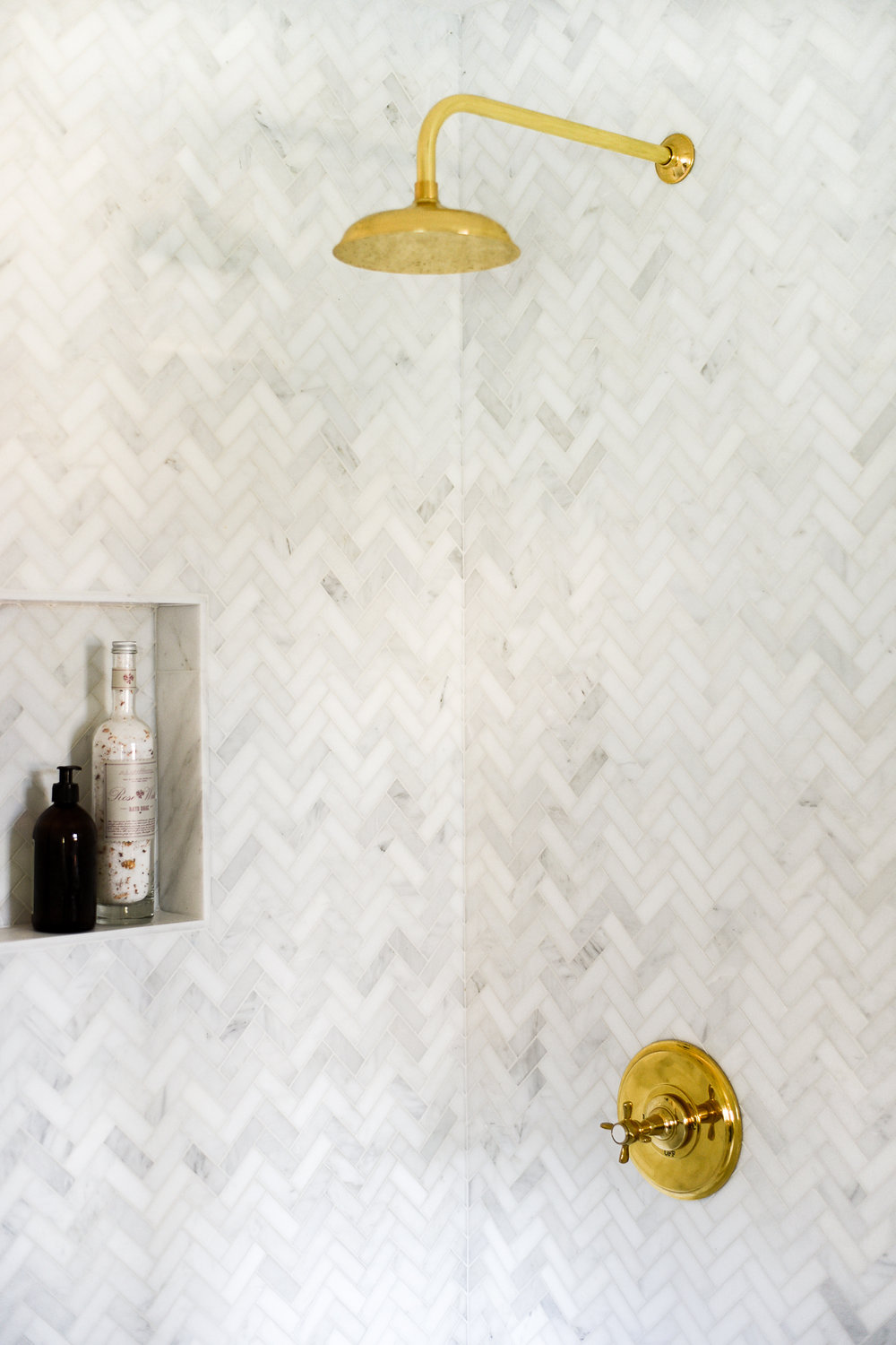 Herringbone Marble Walk-In Shower with Brass Hardware | boxwoodavenue.com