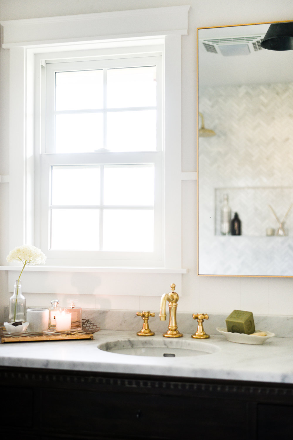Antique Brass Hardware in White Marble Bathroom | boxwoodavenue.com