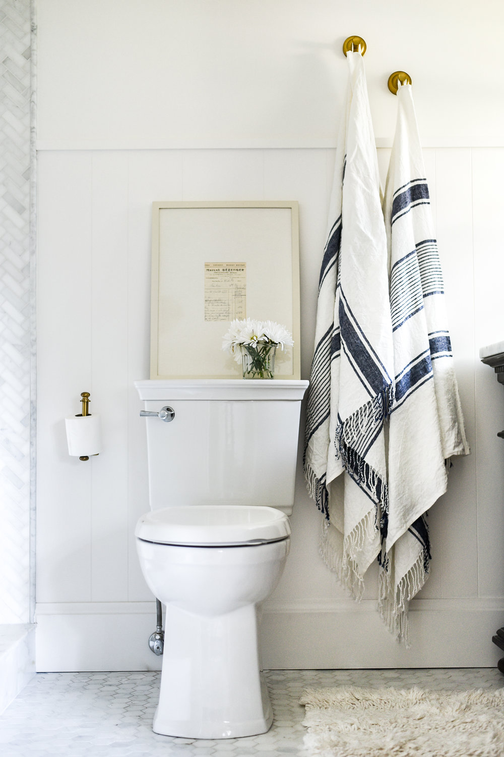 Blue & White Turkish Towels in White Marble Bathroom | boxwoodavenue.com