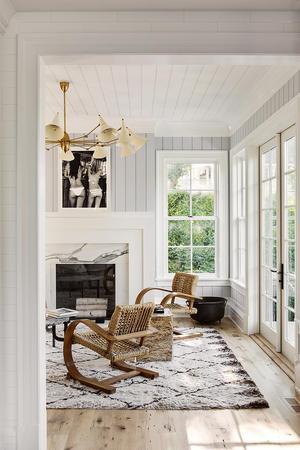 Woven chairs, paneled walls, & moroccan rug [Julie HIllman Deisgn www.juliehillman.com]