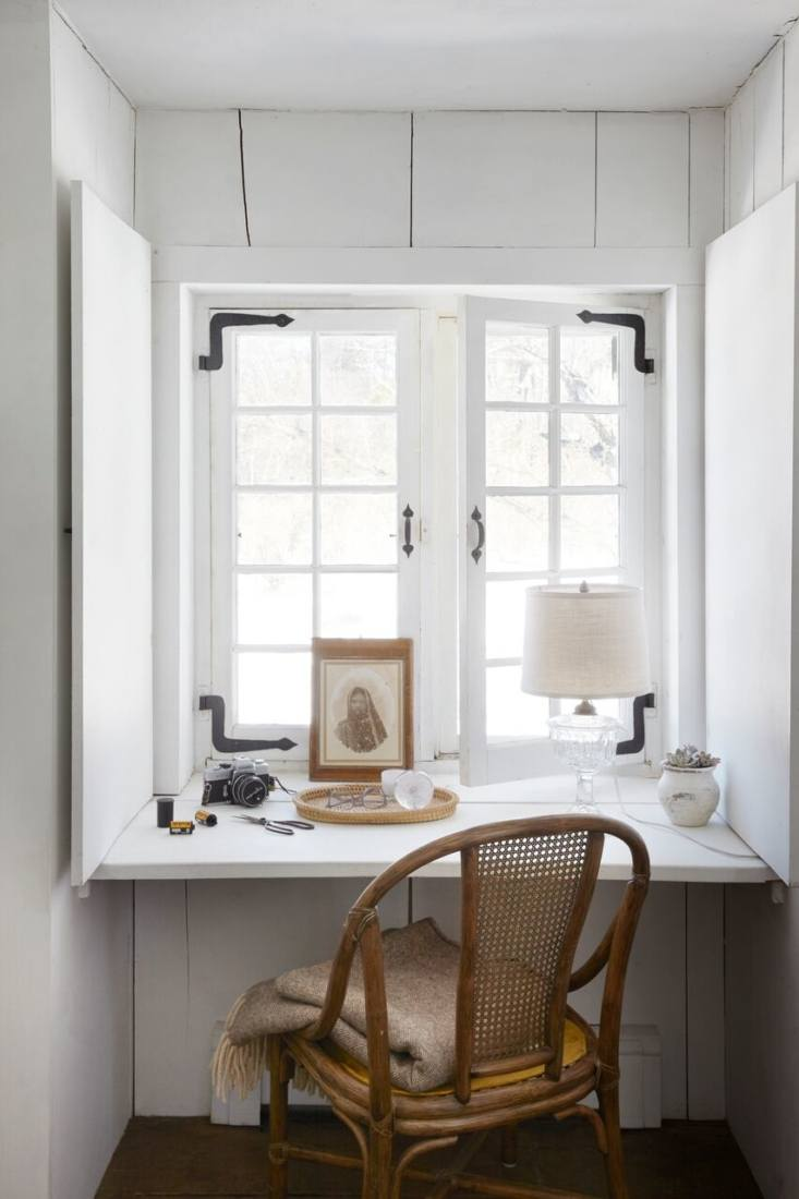Farmhouse nook with wicker chair & vintage decor [Marili Forastieri by Zio & Sons via Remodelista]