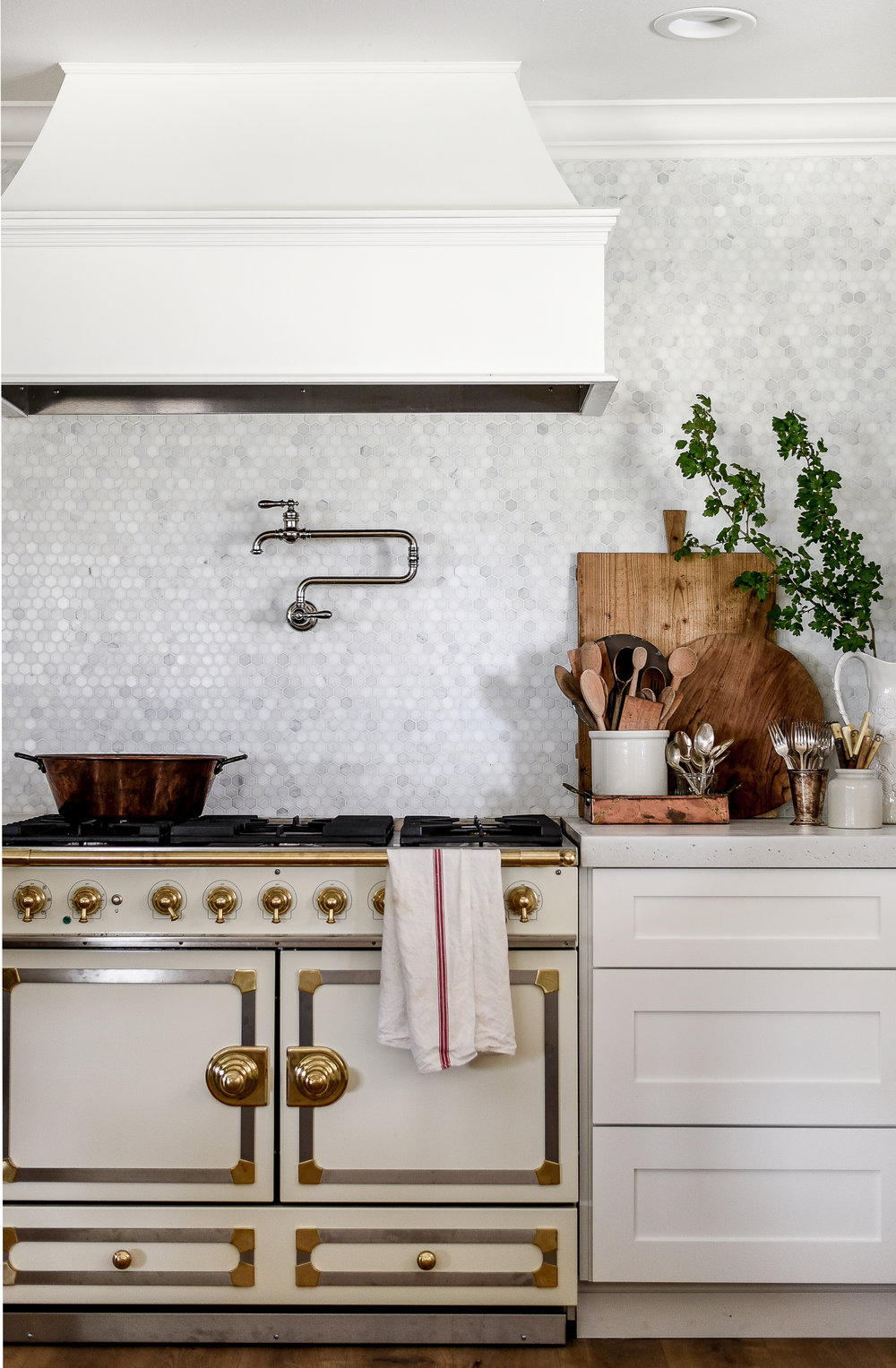 Kohler's artifacts pot filler & la cornue stove - a remodeled farmhouse kitchen | boxwoodavenue.com