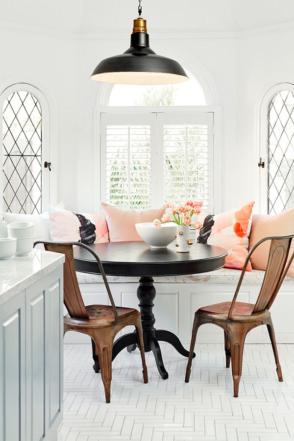 Pink & white industrial dining room of Nina Dobrev