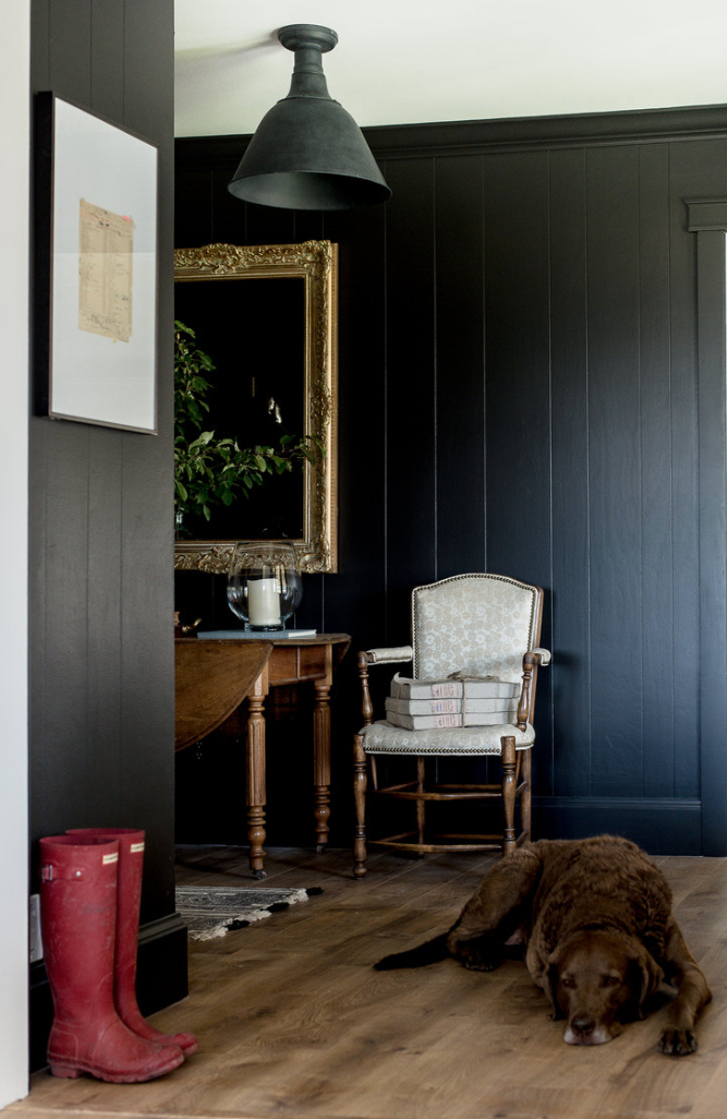 Paneled mudroom - If you have wood paneling in your home, I hope to inspire you to paint it a dramatic color like our French country entryway!