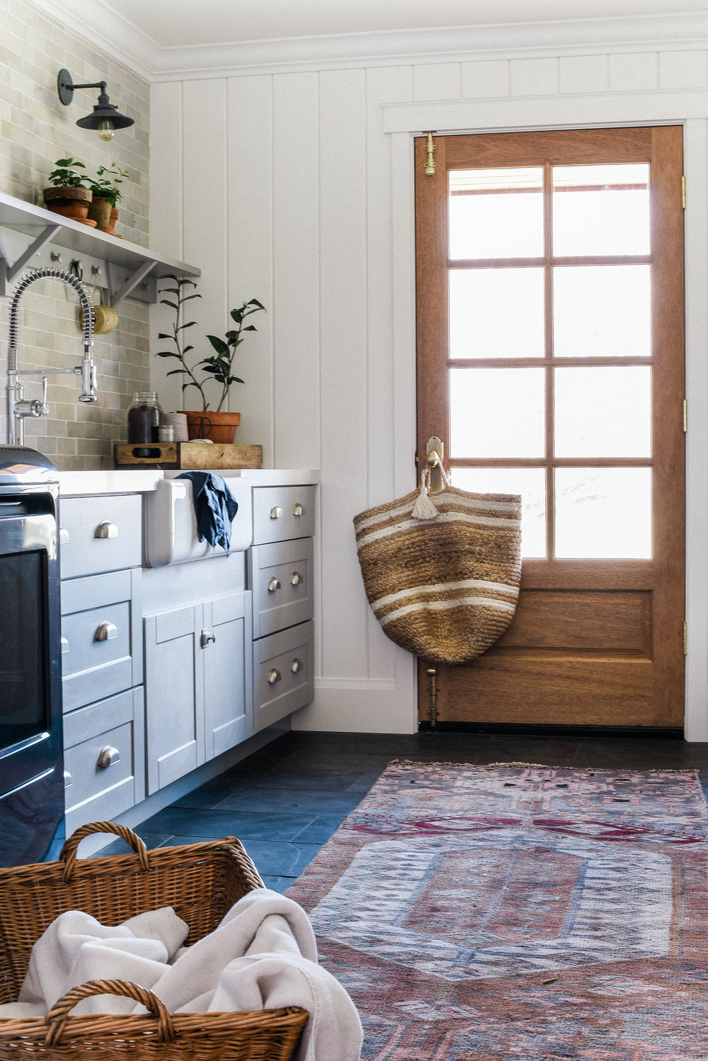 Laundry Room - Our laundry room blends modern design elements with a little French country decor to create the perfect place to complete chores.