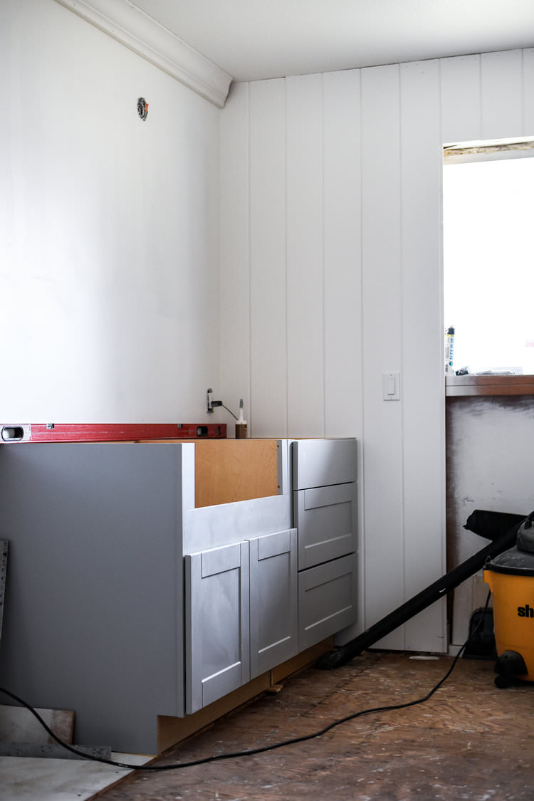 White Vertical Shiplap Gray Cabinets in Laundry Room | boxwoodavenue.com