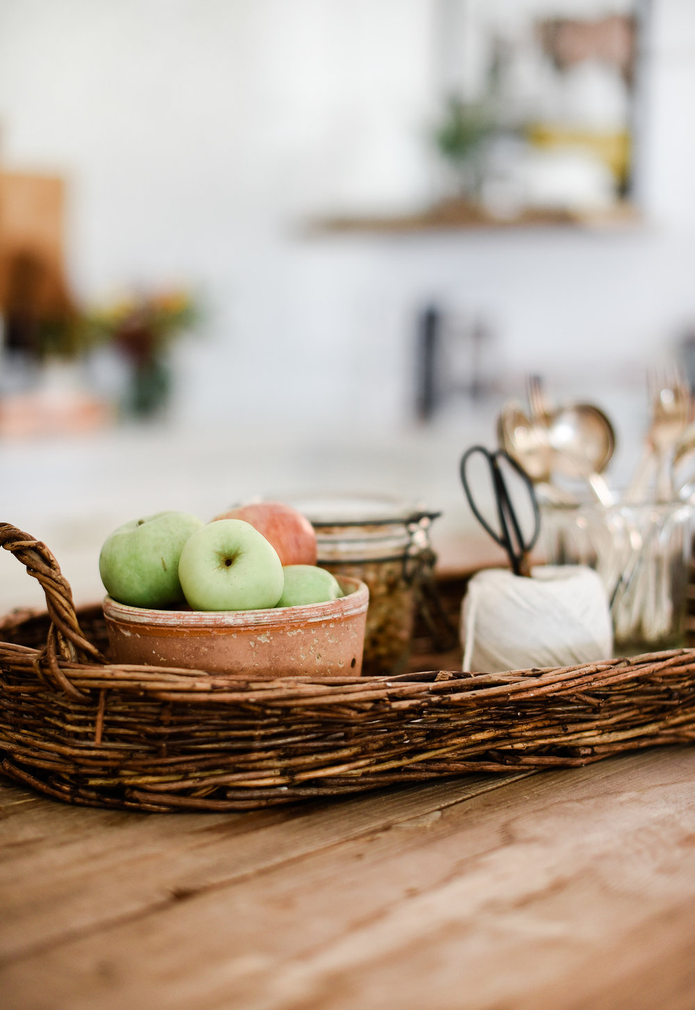 Shop your home. - Find new uses for old things. I typically keep a candle in this vintage cheese mold, but reused it to hold apples as a centerpiece on my island. What do you have in your home that could be repurposed?