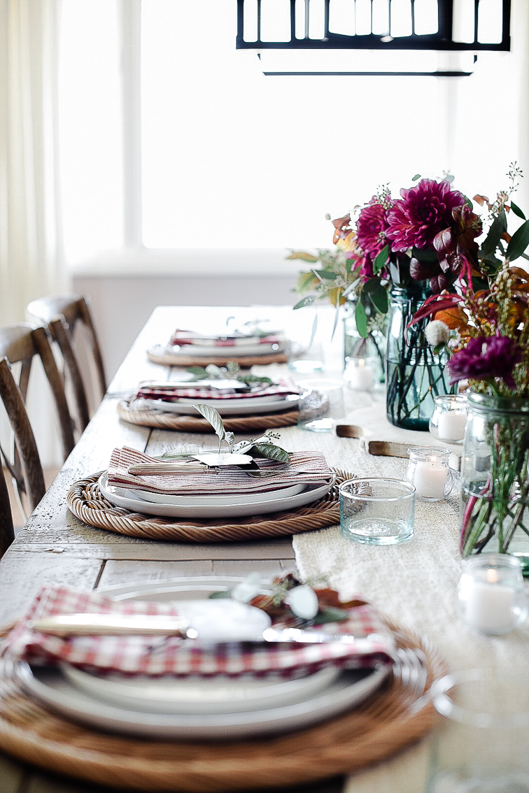 Mix & Match - Pick a color scheme or pattern scheme - like all red, or all plaid - then mix and match to create a fun table where everyone feels at home.tip: use cut squares of fabric as napkins if you'd like to try out a pattern or color that you most likely won't use again!
