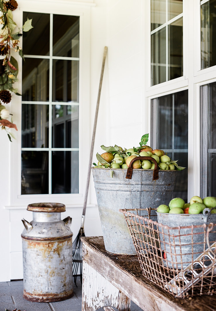 Quick Tip: - If using baskets and buckets as decor, fill them up 3/4 of the way with recycled styrofoam or cardboard first. Then fill the top with apples, pumpkins, or leaves! This will make the bucket easy to move!