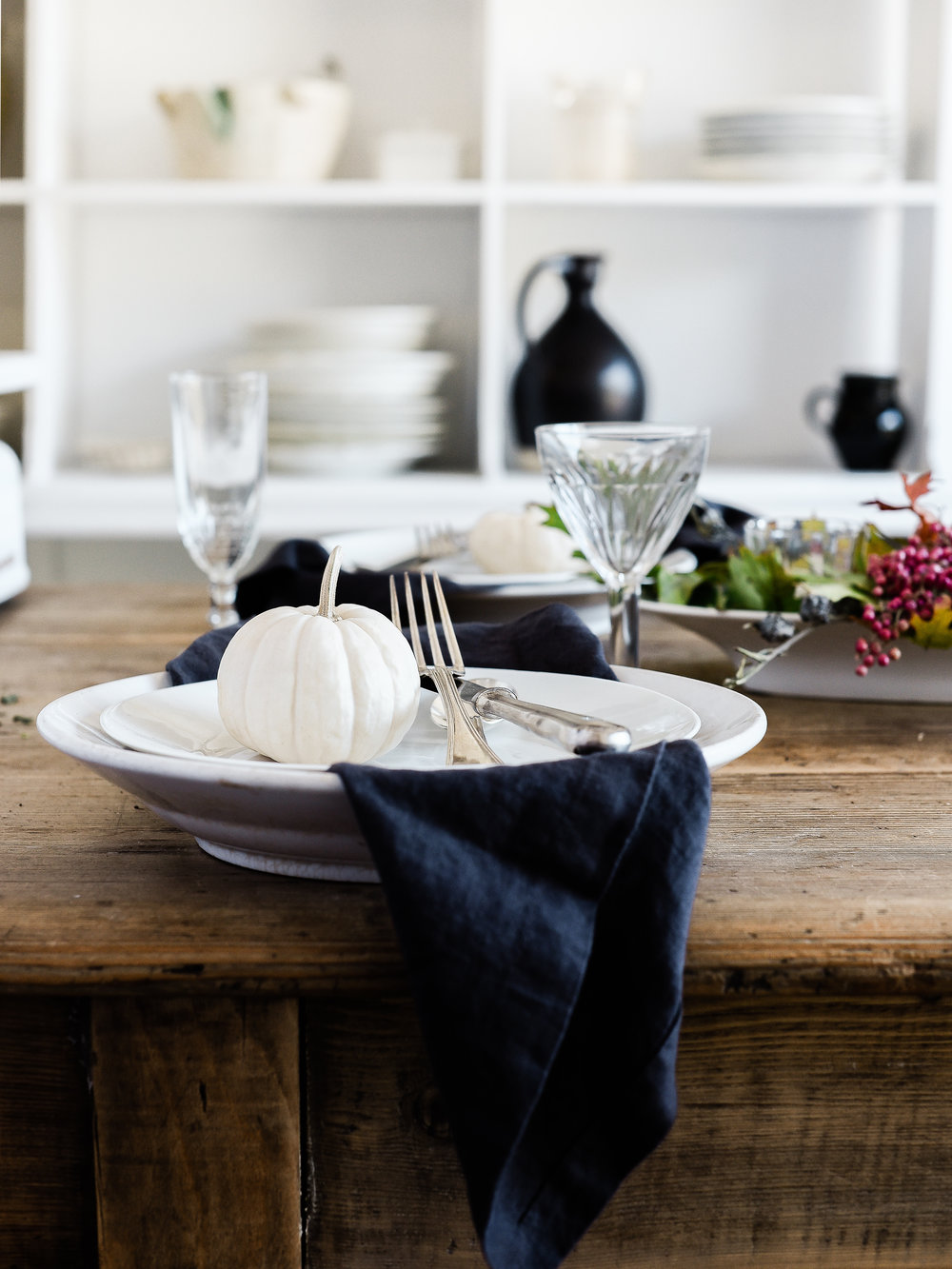Pretty fall tabletop ideas for Thanksgiving with white mini pumpkins.