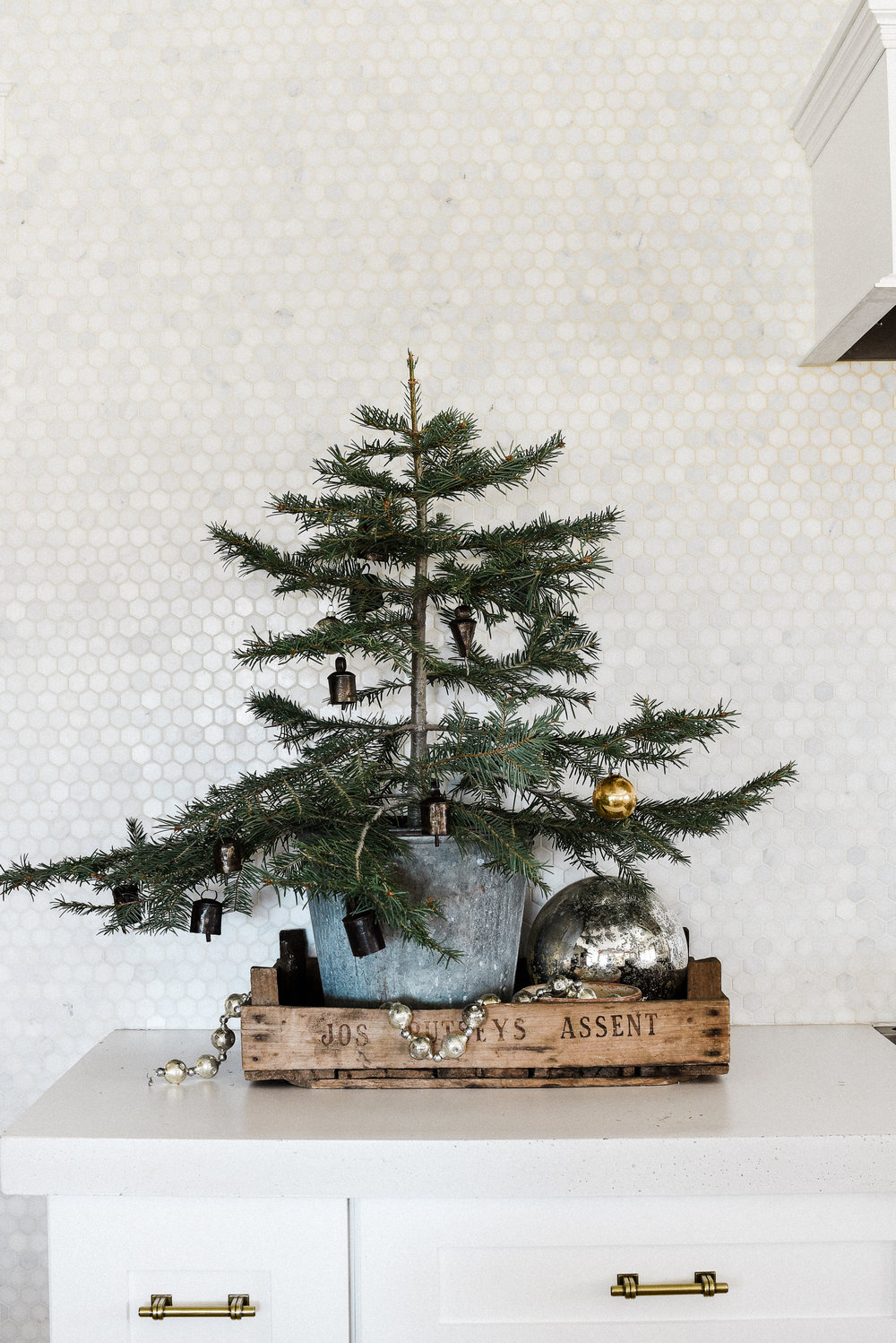 Tiny Scandinavian Christmas tree decorating idea in a zinc bucket for a minimalistic Christmas | boxwoodavenue.com #christmastreedecor #ScandinavianChristmasTree