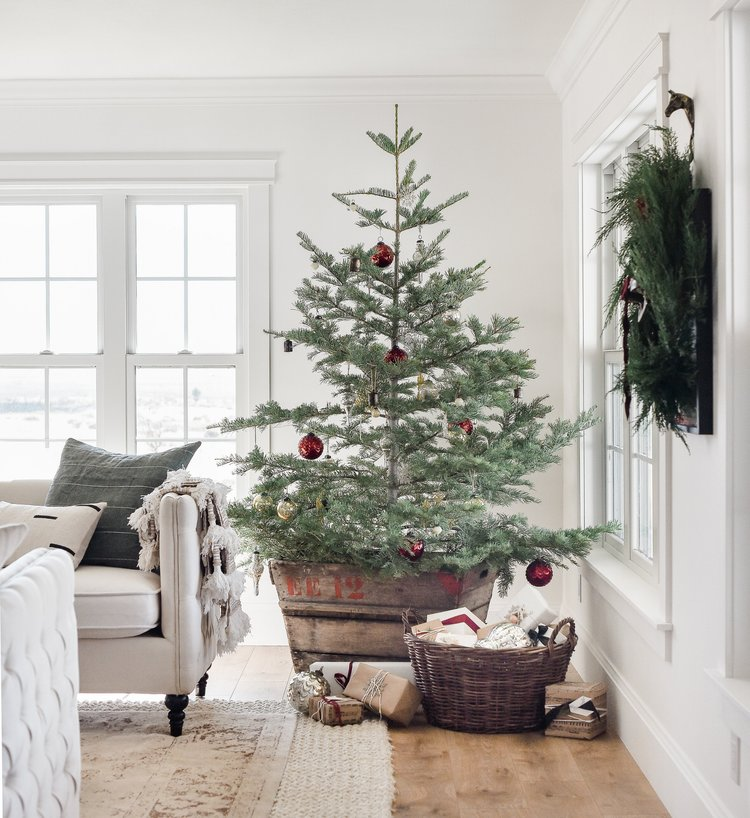 beautiful farmhouse christmas decor with vintage christmas decorations on minimal live tree from boxwoodavenuecom