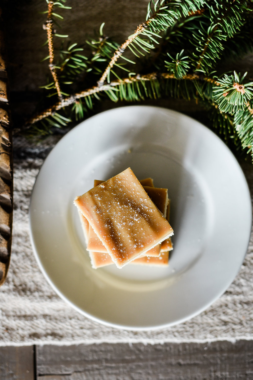 These Christmas shortbread bars are topped with caramel & sprinkled with salt - they are delicious and perfect for this year's cookie swap! boxwoodavenue.com #christmascookies #christmasshortbread