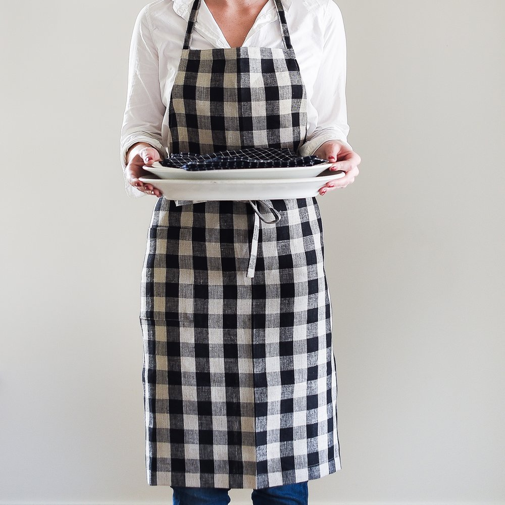A Cute Apron - A cute apron is an absolute must in the kitchen, isn't it? Nothing makes me feel more ready to bake than when I put on my apron. We recently added kitchen linens to our shop, and I have to say, the plaid apron is my favorite!