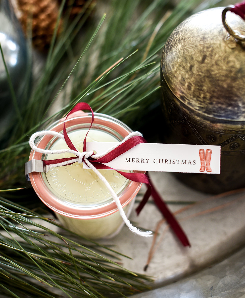 Homemade candles are a great Christmas gift from boxwoodavenue.com with free printable gift tags made with essential oils and beeswax!