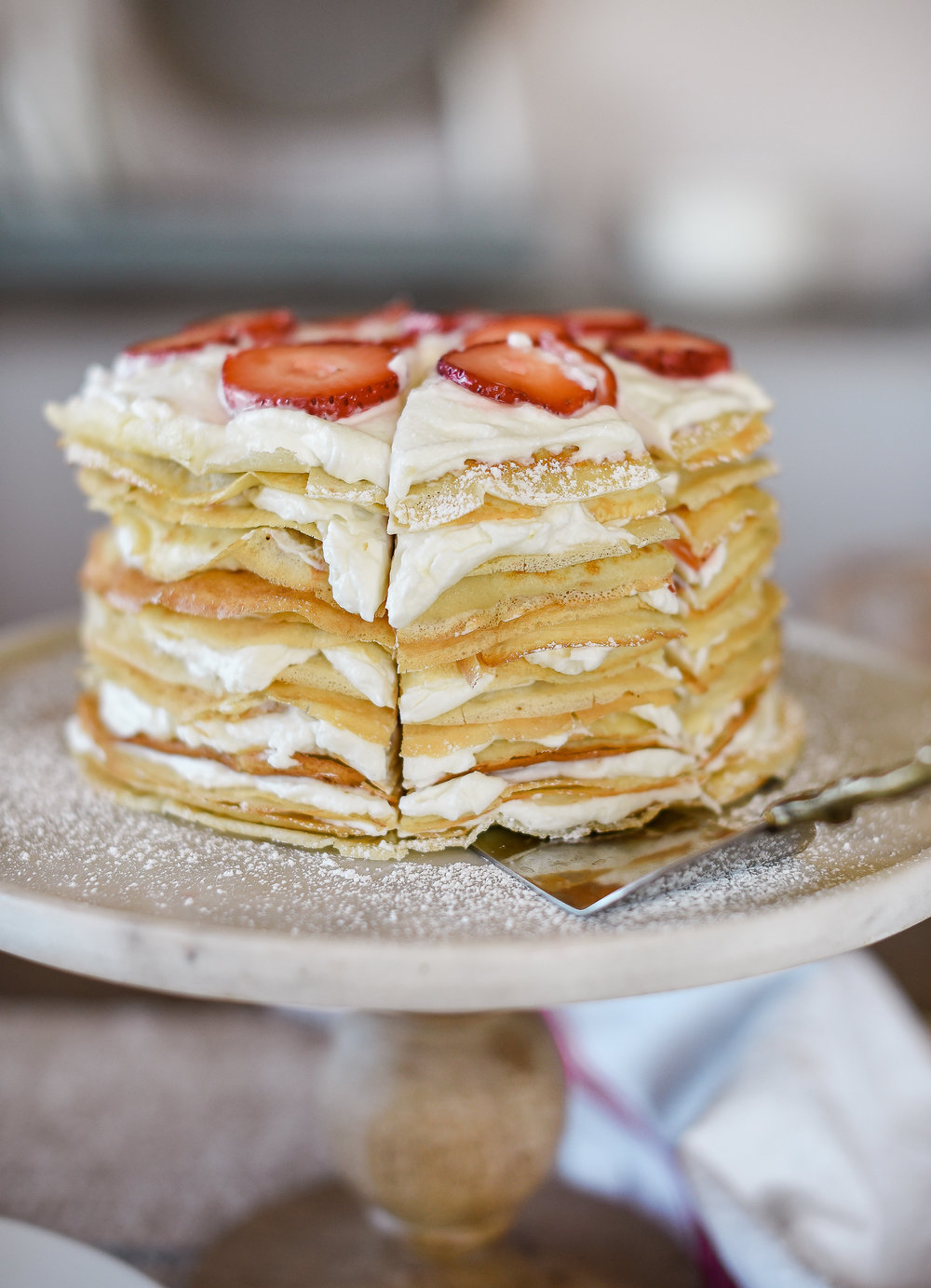 A delicious strawberry & cream filled crepe cake perfect for special occasions | boxwoodavenue.com