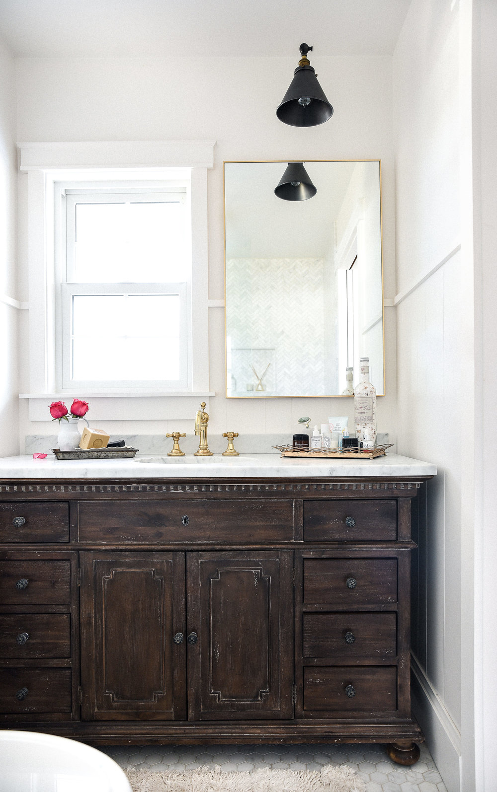 Marble & brass bathroom with vintage dark wood vanity remodel