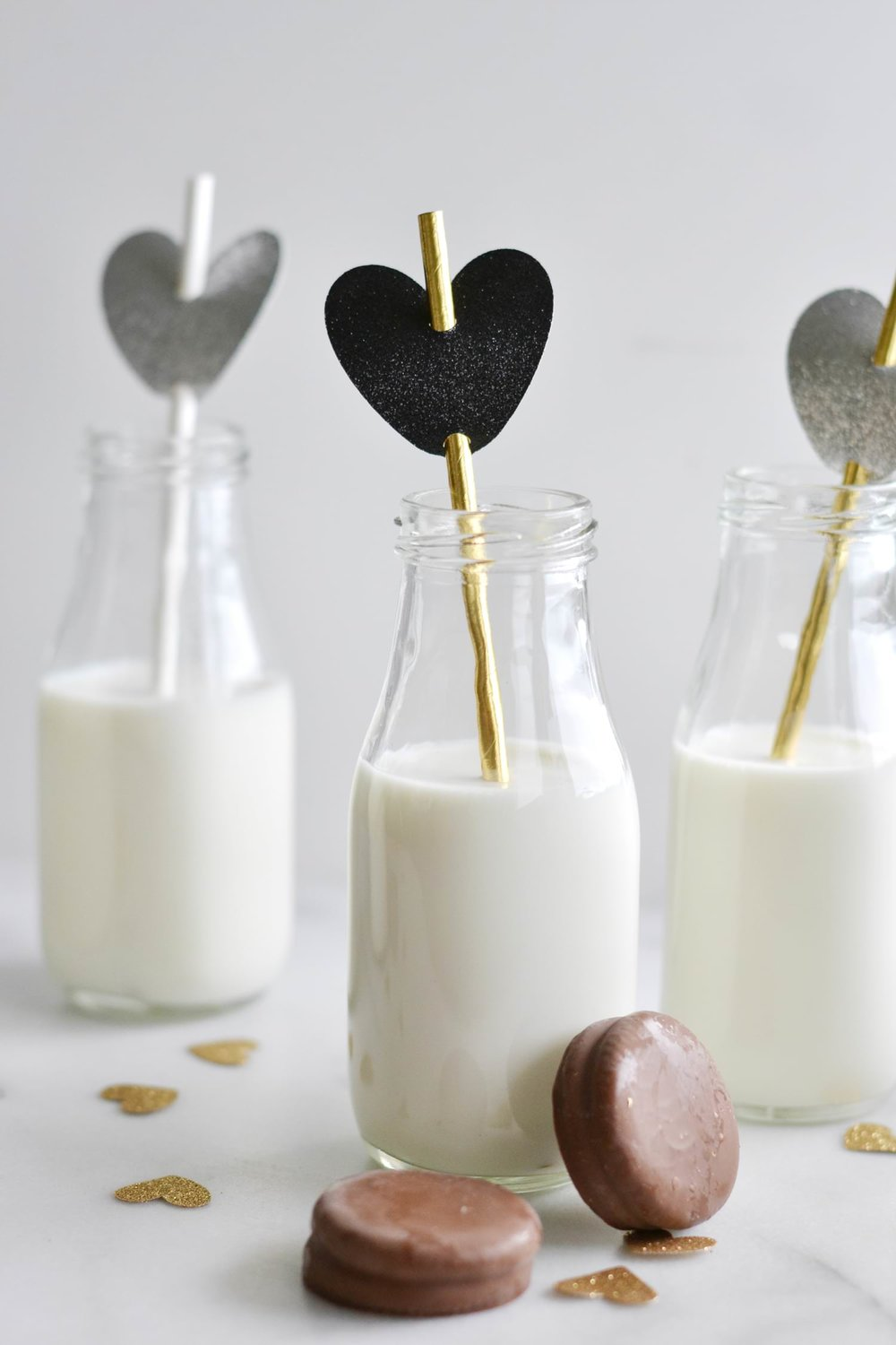 Cute milk and cookies party with hearts and paper straws for Valentine's Day - Boxwood Avenue (Cricut Project)