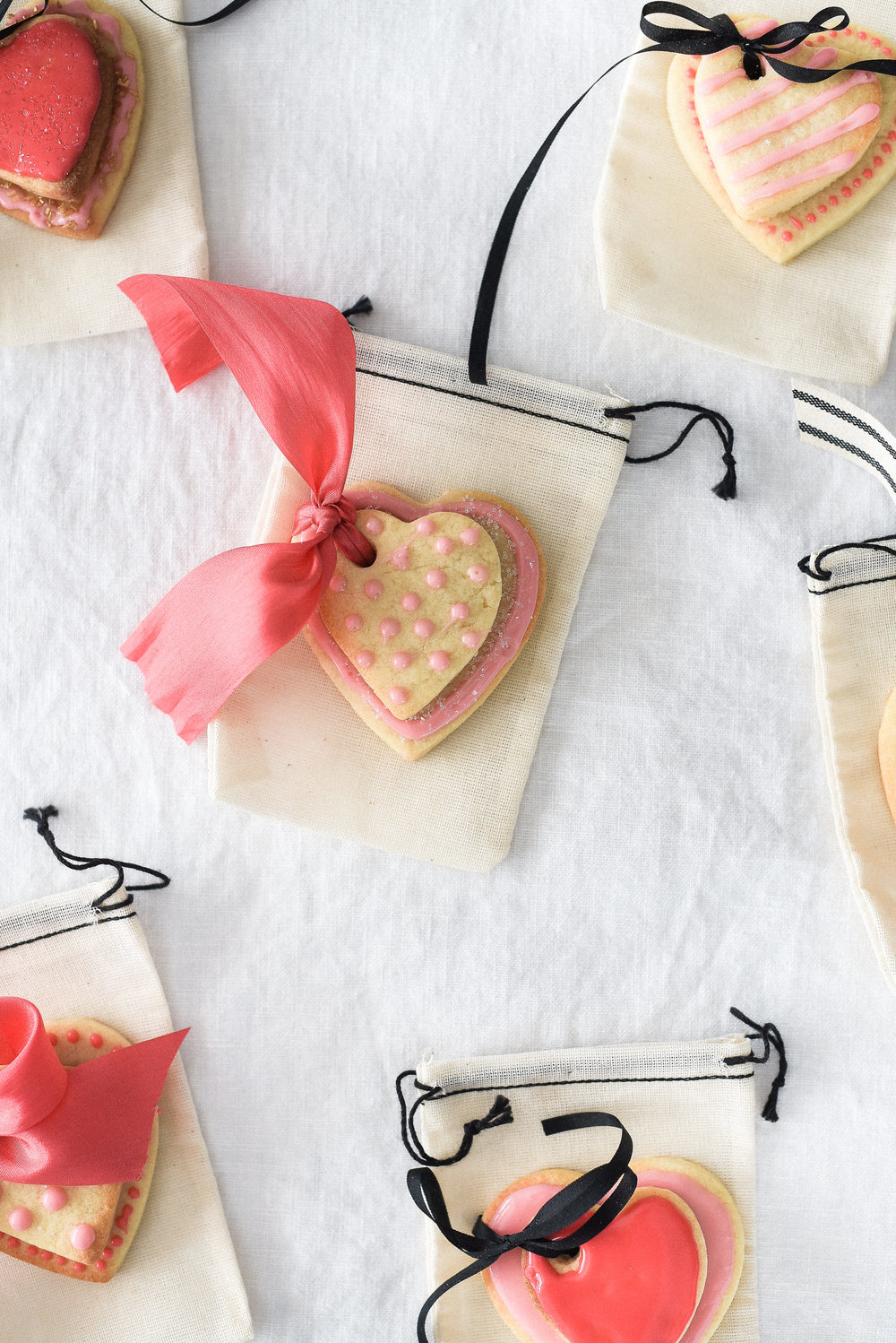 Adorable Valentine's Day sugar cookies heart shaped cookies with royal icing and ribbon | a unique valentine's day treat! #valentinesday #valentinesdaycookies #heartcookies boxwoodavenue.com