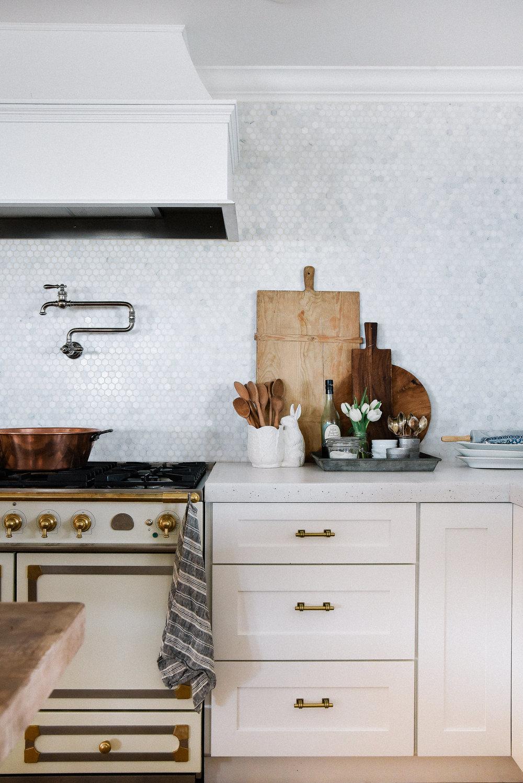 Modern farmhouse kitchen with marble backsplash, white concrete countertops, french range and white shaker cabinets   boxwoodavenue.com #conretecountertops #farmhousekitchen