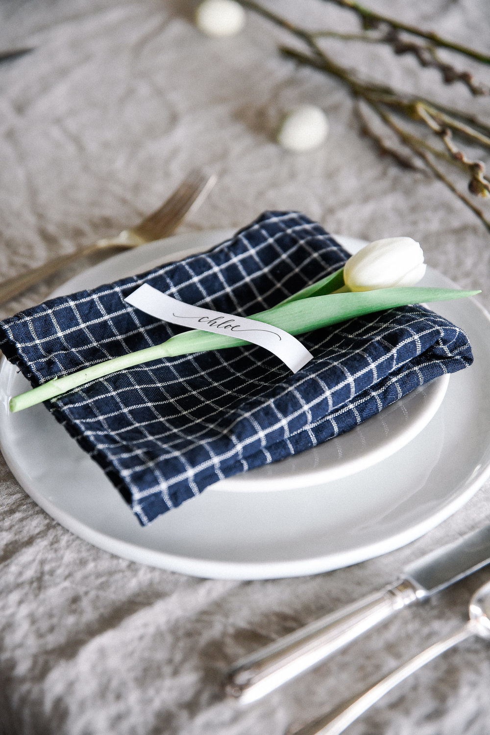 Easter table decor with checker print easter table linens and tulip - boxwoodavenue.com #easter #eastertable #easterdecor