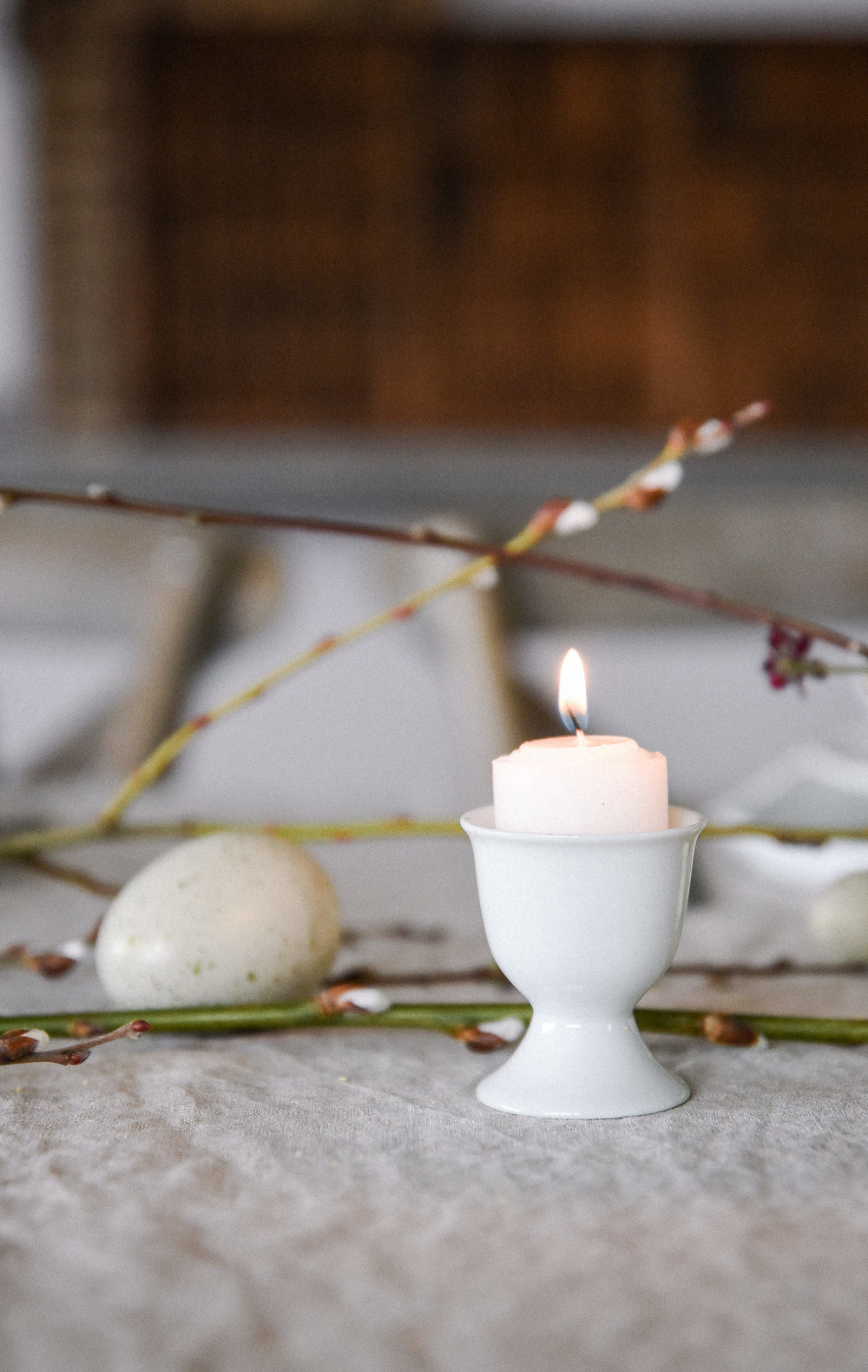 Easter table decorating ideas with using an egg cup as a candle holder   boxwoodavenue.com #easterdecor #eastertable #eastertablescape