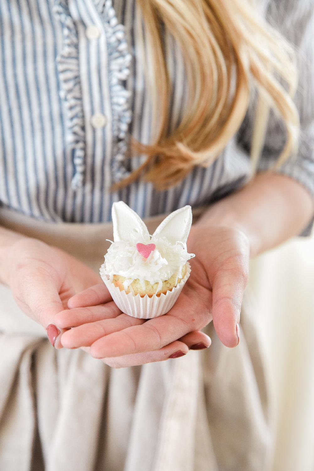 The sweetest Easter dessert idea! Easter bunny sugar cookies! Sugar cookies filled with a light and fluffy cream cheese frosting, topped with shredded coconut, and marshmallow bunny ears! boxwoodavenue.com #easterdessert #eastersugarcookies #easterbunnycookies