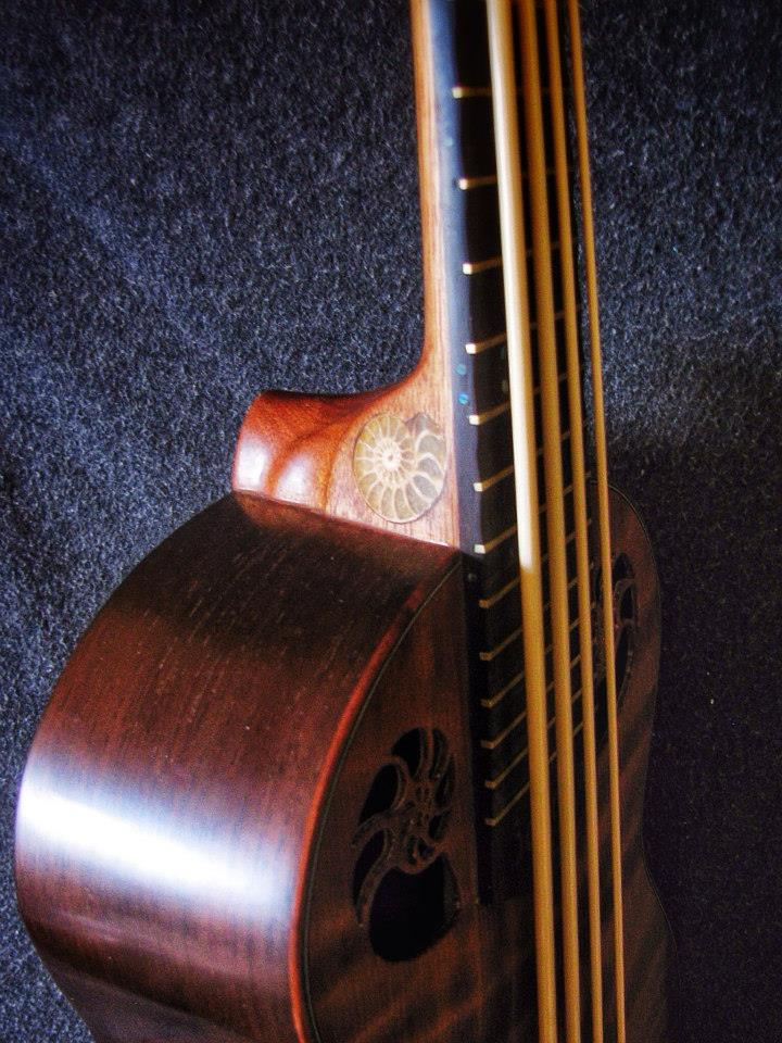 Ukulele Bass made to stand apart from the rest! Ammonite fossil inlay on heel