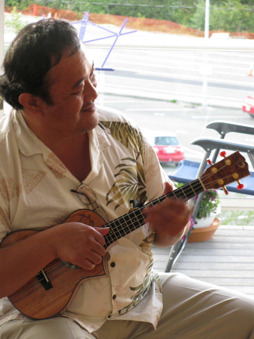 Moses Kamai enjoying his Oceana Ukulele