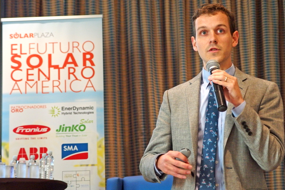 Adam James (GTM Research) speaking at the 'El Futuro Solar' conference, part of the trade mission
