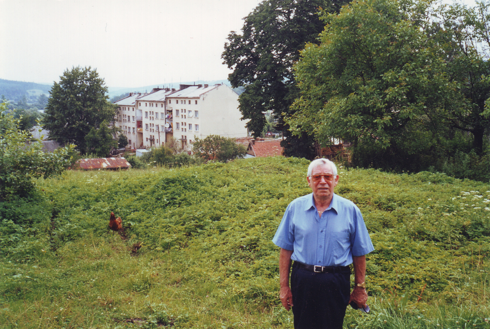 Yagel standing in the location of his childhood home.  Birza, Poland.  1998