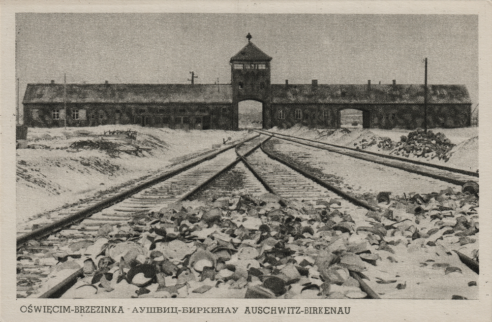 """Gate of death."" Auschwitz-Birkenau, undated. Postcard."