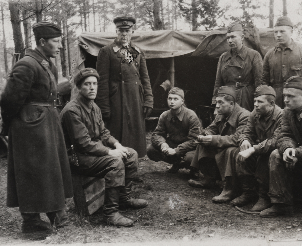Arkady Tsenzor, sitting third from right. Aircraft maintenance crew. Air base Gorelovo, Russia. 1944.