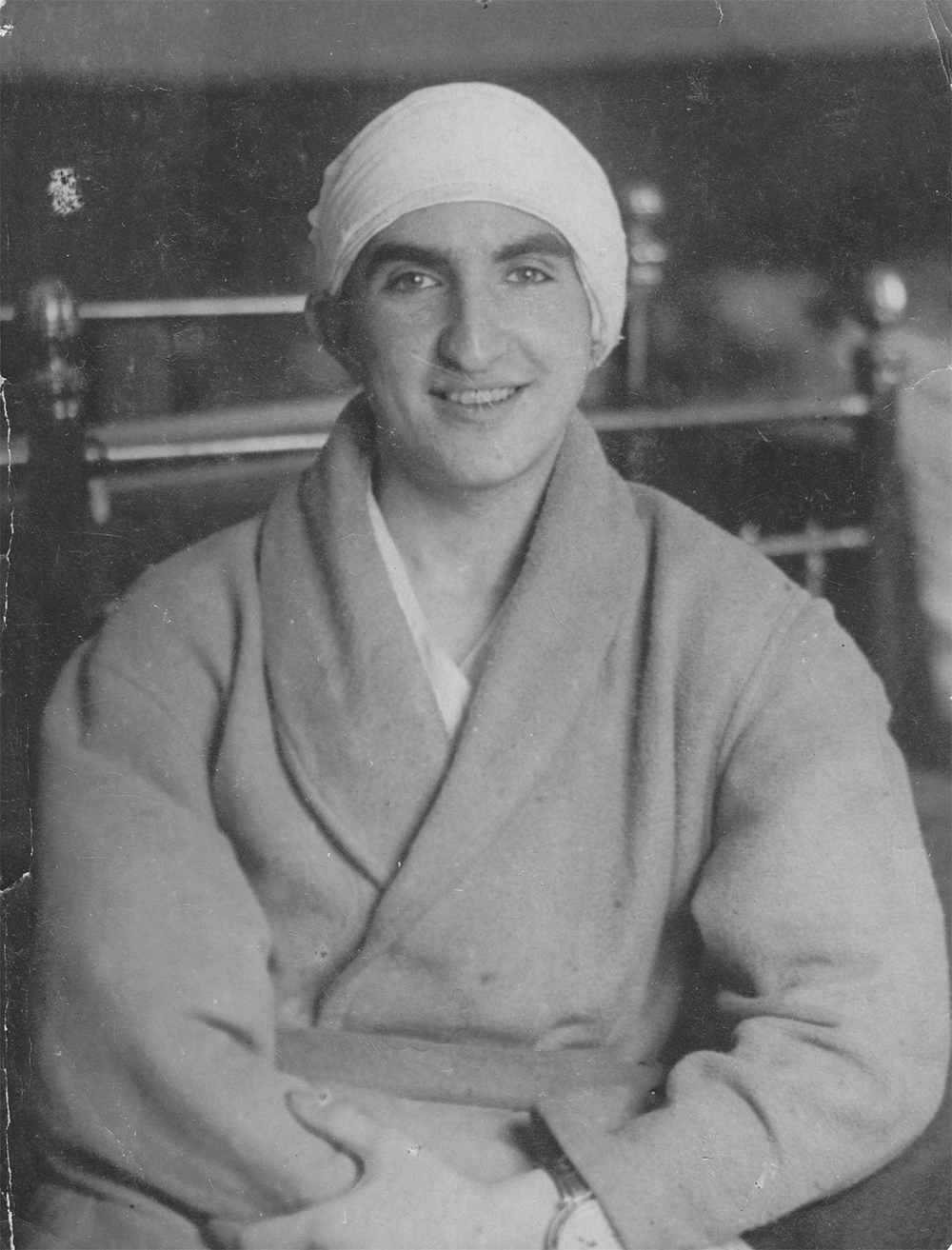 Mark Espthein in the hospital after a serious head injury, with bandage around his head, and wearing a hospital robe. 1943. In total, Mark Epshtein was wounded five times during the war.