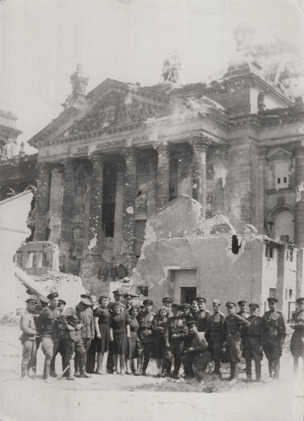 Photograph taken in celebration of Germany's capitulation. Kashper (left) with his military unit in front of the Reichstag. Berlin, May 1945