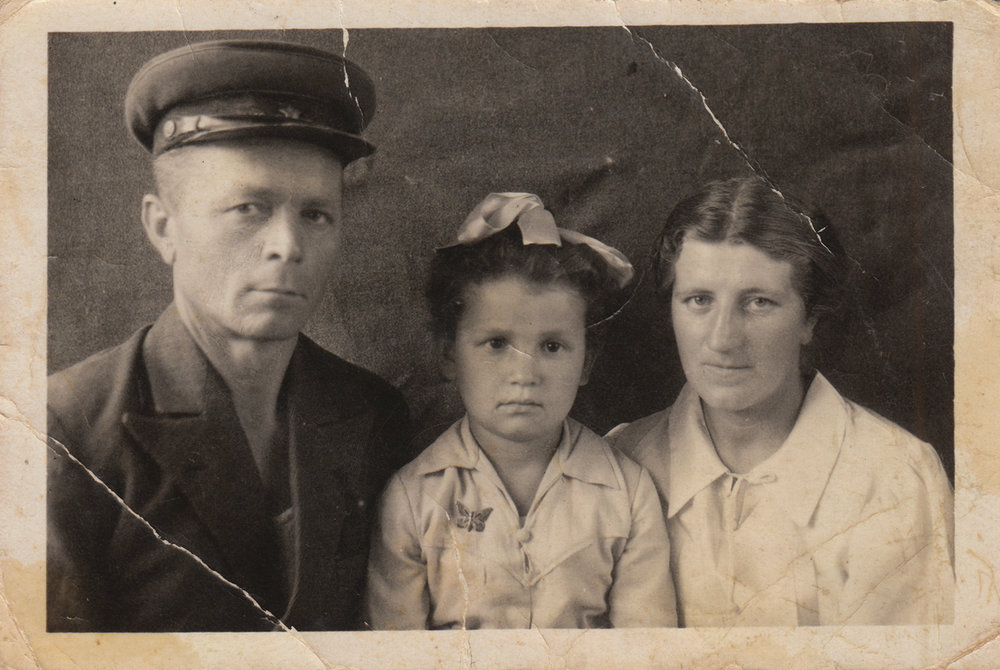 Nyusya with her adopted parents, Ivan Vasilievich Habrat and Maria Vasilievna Habrat, 1940.