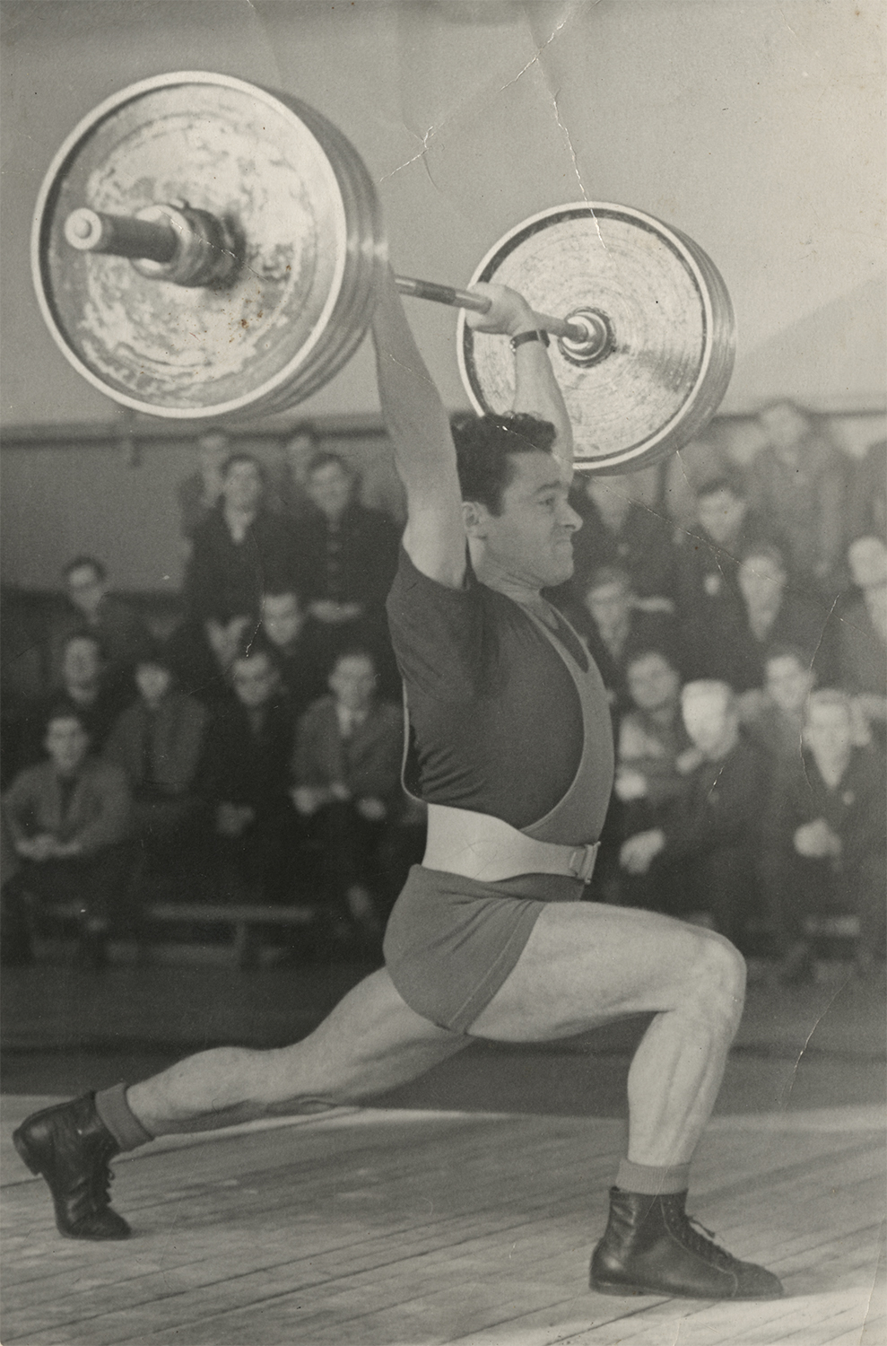 Leonid Bronstein lifting a barbell.
