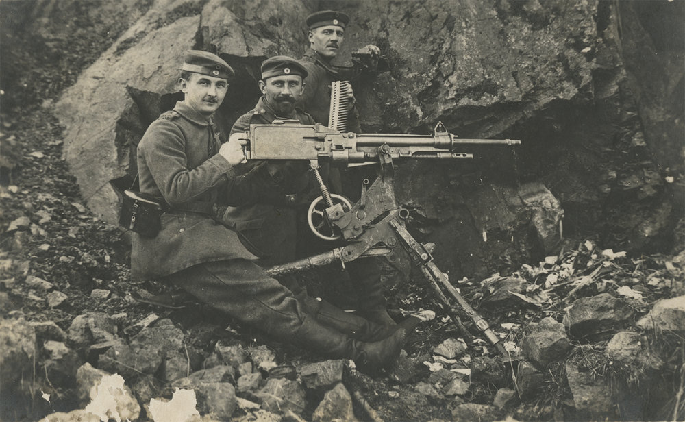 Three soldiers and a machine gun. ca. 1914-1918