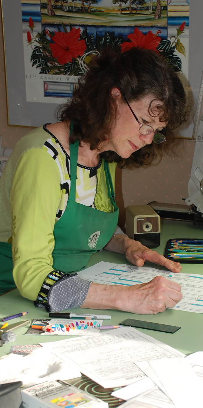 Lynn Corrie at the drawing table.