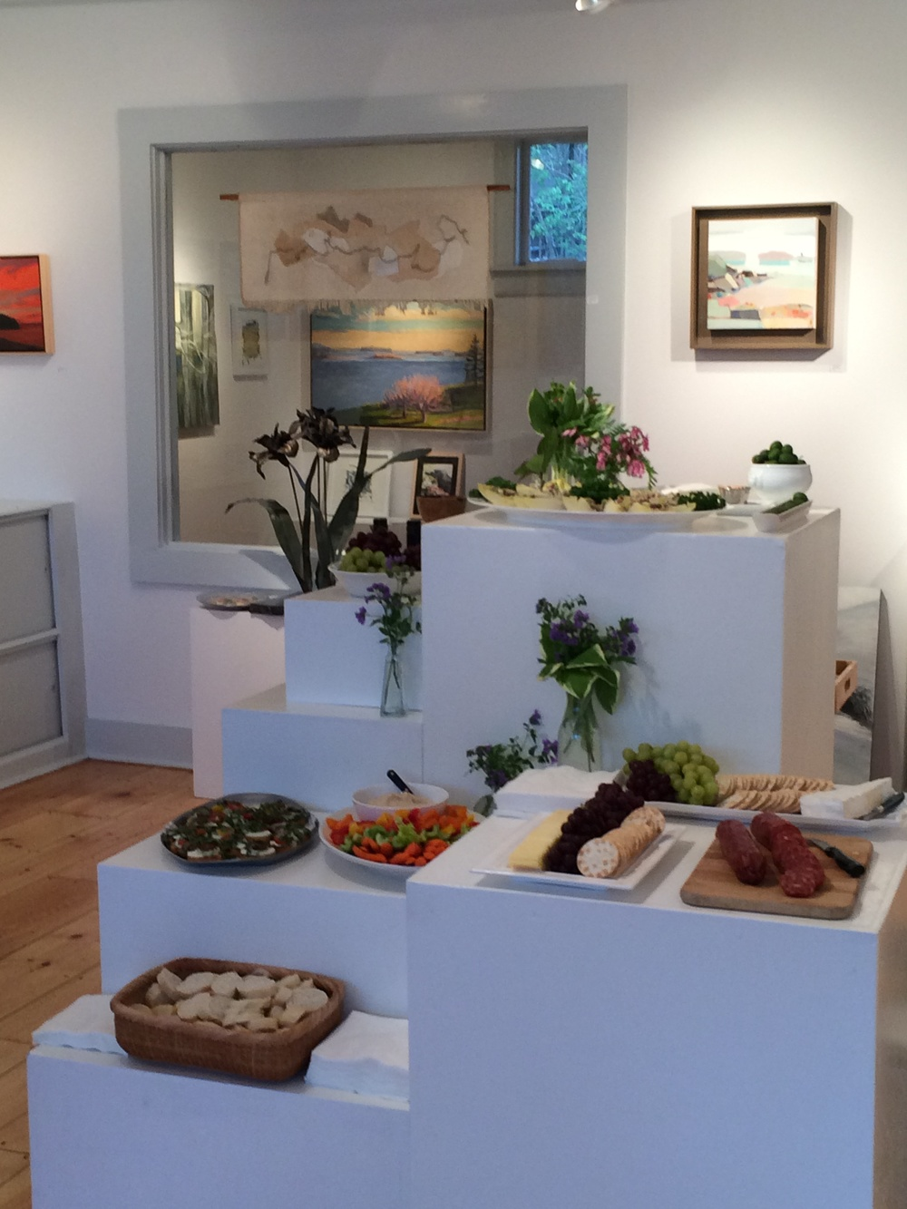 left to right I see artwork by Susan Parish Adam, Kara Taylor, Gayle Lewis, Louise Bourne, Liddy Fitz-Gerald (above), and Hannah Bureau. Also I see those incredible green olives from Max at the  Blue Hill Wine Shop