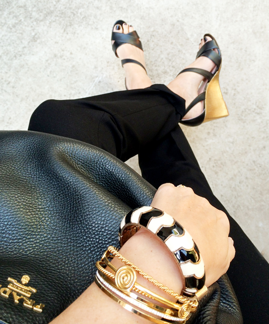 "Another must is animal print and gold. Perfect for dressing up an ""all black"" oufit. Zebra bracelet from JCrew ; Gold bracelets from  Michael Kors ."