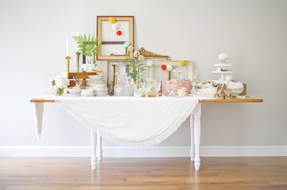 A wonderful Tablescape filled with Vintage dishes, glassware, fashion, and decor