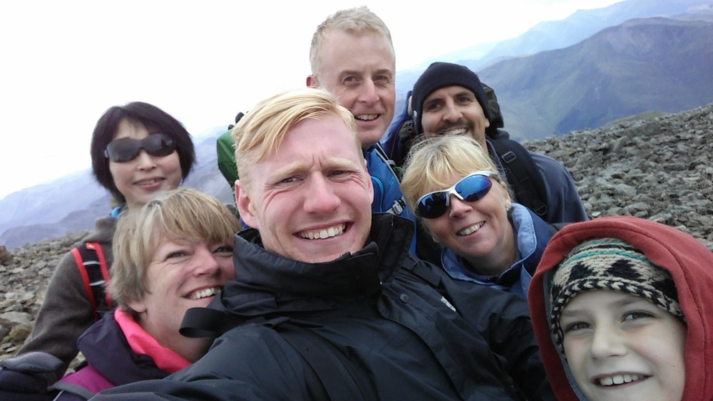 Top of the mountain group selfie!
