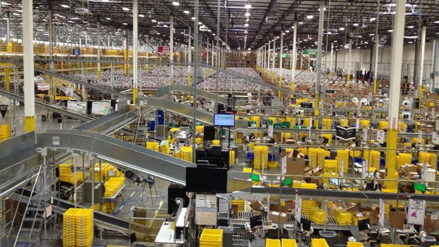 The interior of an Amazon.com warehouse. It's mind-boggling how much automation is going on in these warehouses!