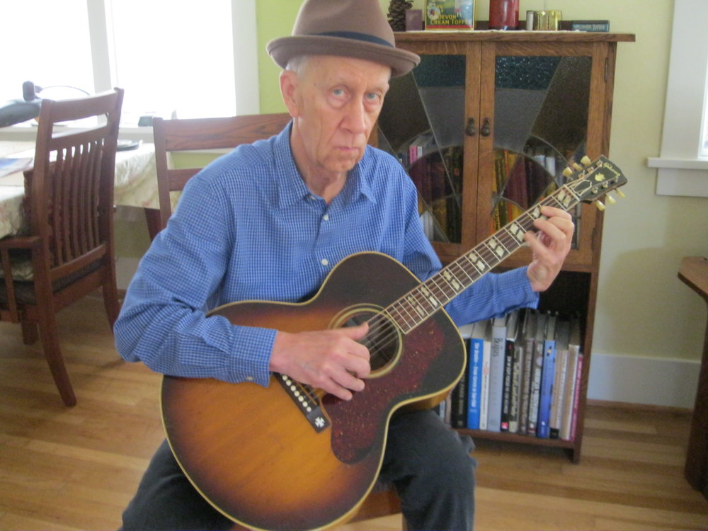 James Clem with his 1952 Gibson J-185 guitar .