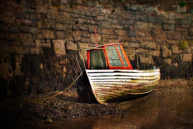 Iris Boat at Low Tide